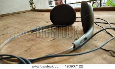 closeup stylish head phone on wood background