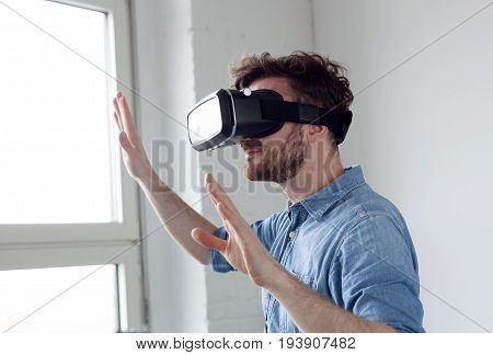 amazed man wearing VR - virtual reality glasses