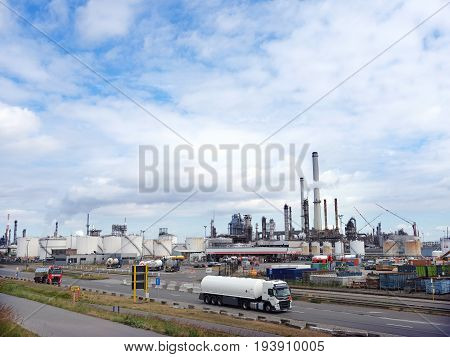 antwerpen Belgium 26 june 2017: tank trucks pass esso refinery in belgian port of antwerp