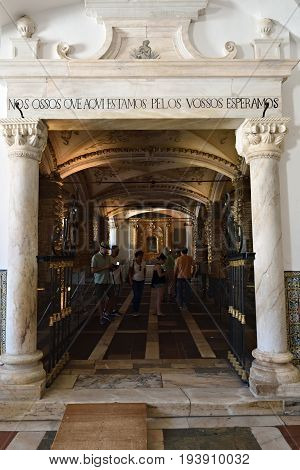 Evora Portugal - June 12 2017: Entrance in Chapel of Bones is one of the best known monuments in Evora. The message above entrance means: