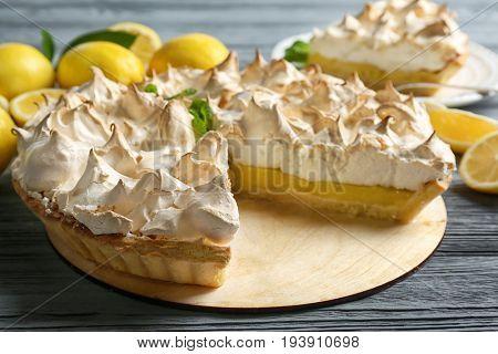 Yummy lemon meringue pie on wooden table