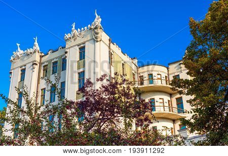 Architecture of the house with chimeras against the blue sky in Kiev.Ukraine