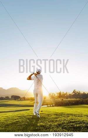 Young Man Playing Golf On A Sunny Day