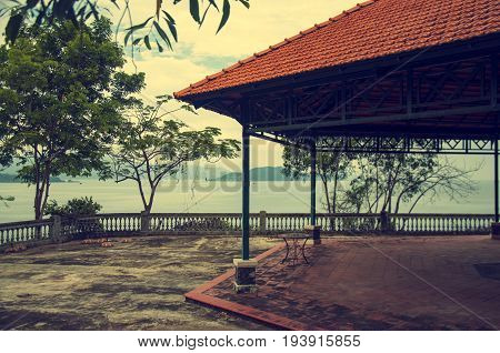 Parapet on the waterfront by the sea with a picturesque gazebo.
