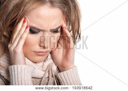 Young woman with headache isolated on white background