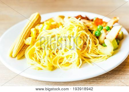 Pasta or spaghetti with sausage in white plate - color filter processing.