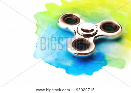 Chrome beautiful spinner on watercolor background with splashes. Isolated on white background.