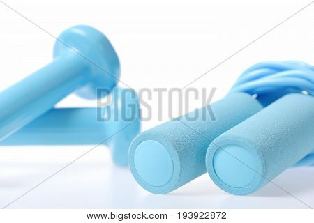 Rope For Skipping In Turquoise Colour Near Cyan Blue Dumbbells