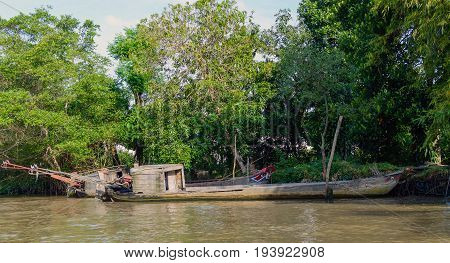 Wooden Cargo Boat On The Mekong River Delta
