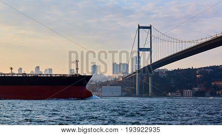 Turkey, Istanbul, Bosphorus Channel, Bosphorus Bridge, an cargo ship under the Bridge