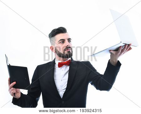 Businessman With Beard Or Director With Curious Look Holding Laptop