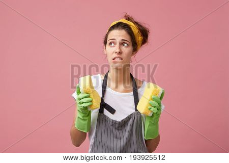 Housekeeping, Housework, Hygiene And Cleaniness. Frustrated Young Female In Apron And Protective Glo
