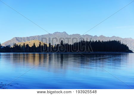 Beautiful serenity of Lake Wakatipu in Queenstown in Autumn South Island of New Zealand