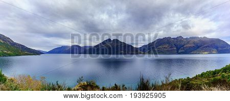 Panoramic serenity of beautiful Lake Wakatipu in Autumn Queenstown South Island of New Zealand