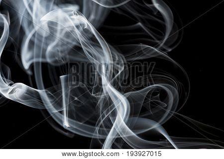 a white moke on a black background