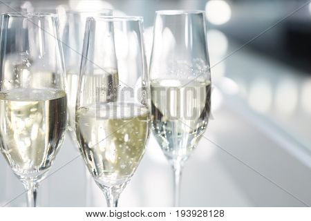 Champagne glasses on white background in bright lights. Fashion show backstage