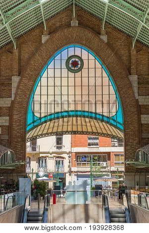 VALENCIA, SPAIN - JUNE 12, 2017: Colorful window at the entrance of the Mercado Colon of Valencia, Spain