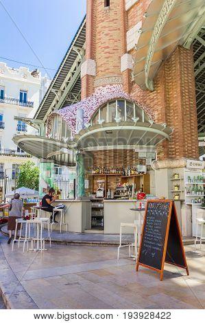 VALENCIA, SPAIN - JUNE 12, 2017: Little cafe at the Mercado Colon market hall in Valencia, Spain