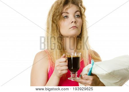 Tired sleepy and grumpy woman holding toothbrush and coffee going to brush her teeth after hot drink.