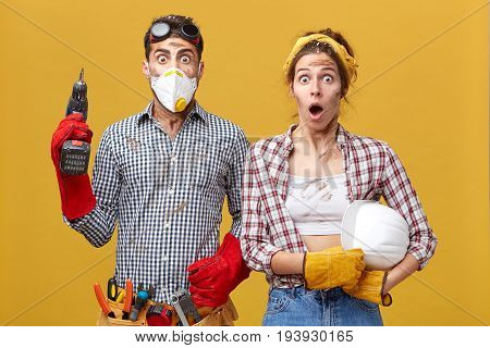 Portrait Of Young Family Couple Wearing Protective Clothes While Doing Repearing In Their Appartment