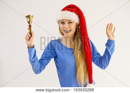 Christmas Woman Holding Bell.