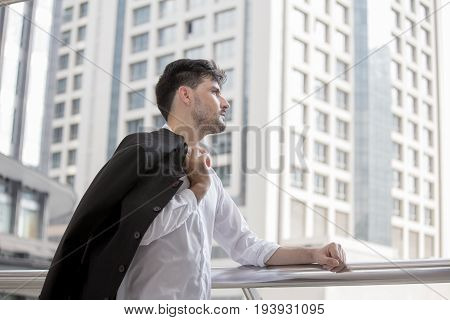 Man Resting For Work And Look At The City, Businessman With Business Success Concept. 20-30 Year Old