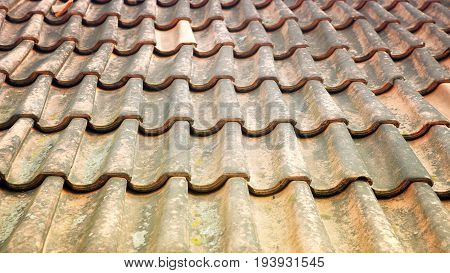 cloesup of old weathered roof with red tiles