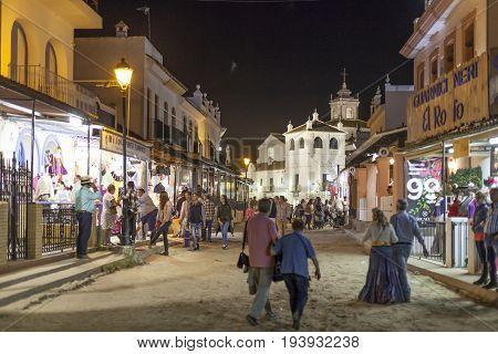 El Rocio Spain - June 4 2017: Street scenery in El Rocio at night during the Romeria 2017. Province of Huelva Andalusia Spain