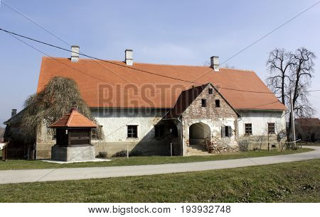 village house with well in Slavonia, Croatia