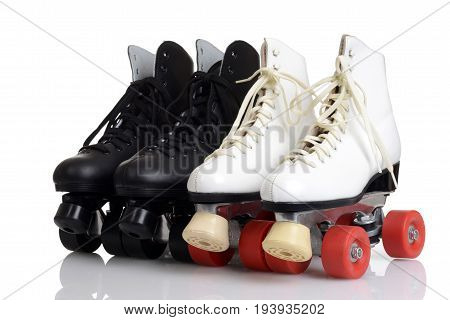 men and women quad roller skates on white