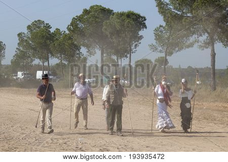 El Rocio Spain - June 1 2017: Pilgrims in traditional spanish dress on the road to El Rocio during the Romeria 2017. Province of Huelva Almonte Andalusia Spain
