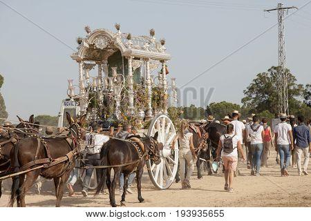 El Rocio Spain - June 1 2017: Pilgrims procession on the road to El Rocio during the Romeria 2017. Province of Huelva Almonte Andalusia Spain