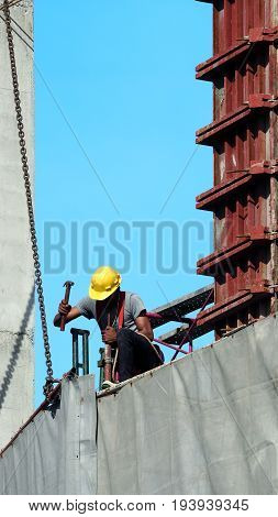 People Working On Construction Site With Yellow Helmet