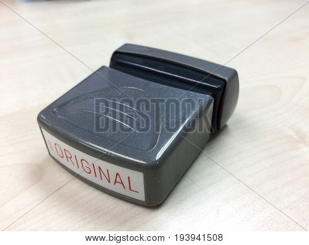 Original text rubber stamp isolate on wood background