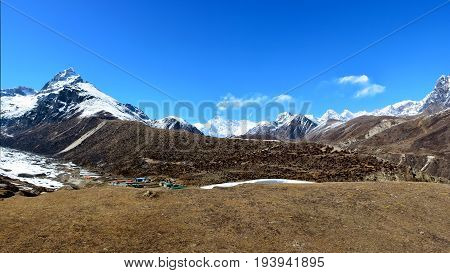 Panoramic view of the Cho-Oyu mountain ridge and Machhermo village. Himalayan mountains Nepal