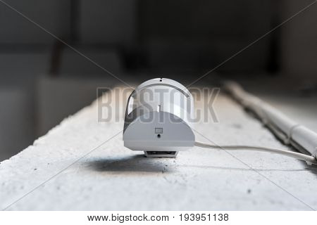 Bottom View Of One Motion Sensor On White Wall