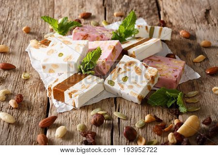 French Fresh Nougat With Nuts And Pumpkin Seeds Close-up. Horizontal