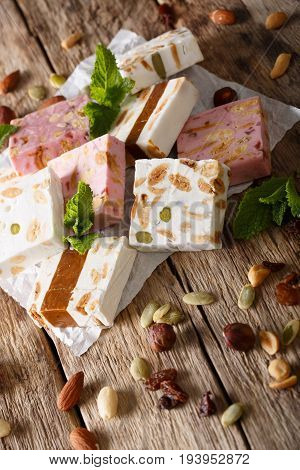 Honey Nougat With Nuts Decorated With Mint Closeup. Vertical