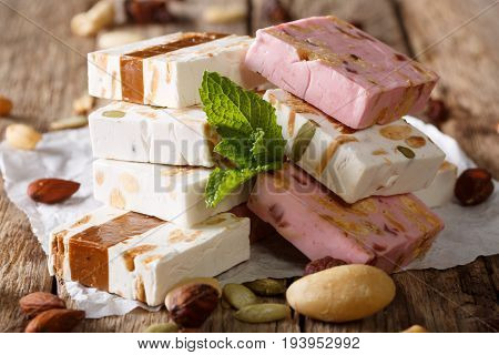 White, Pink And Brown Nougat With Nuts And Mint Closeup. Horizontal, Rustic