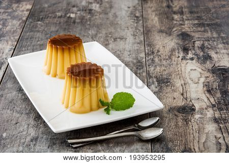 Creme caramel. Egg pudding on wooden table