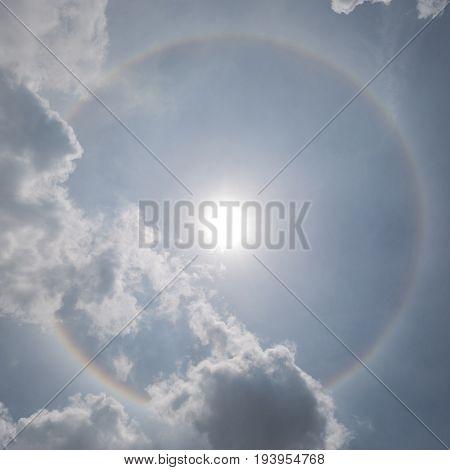 The sun halo (optical phenomena) with cloudy sky in background natural phenomenon.