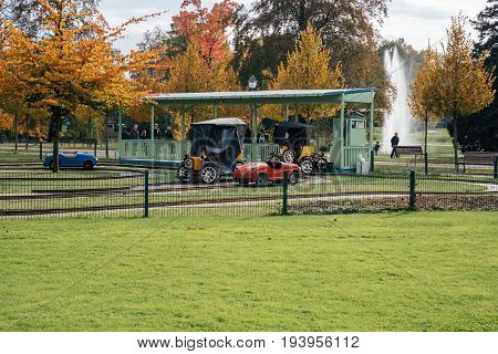 STRASBOURG FRANCE - OCT 24 2016: Green park with kids cars playground attraction in Strasbourg Orangerie Park
