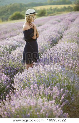 Beautiful woman enjoy life outdoors. Woman at lavender field. Smiling beautiful woman enjoy life outdoors. Woman at lavender field.