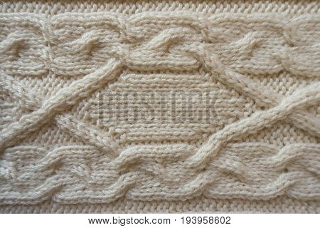 Cream Handmade Knitwork With Horizontal Plait Pattern From Above