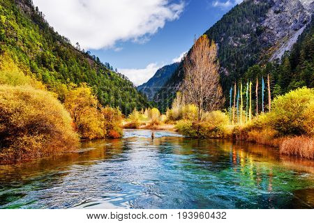 Amazing View Of Scenic River With Crystal Water Among Mountains