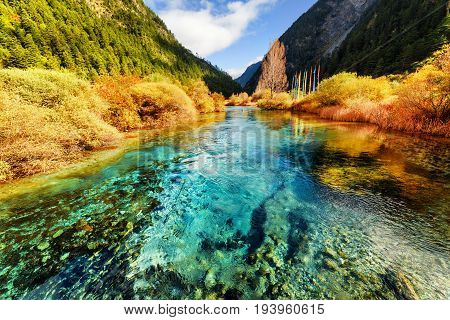 Beautiful Azure Crystal Clear Water Of River In Mountains