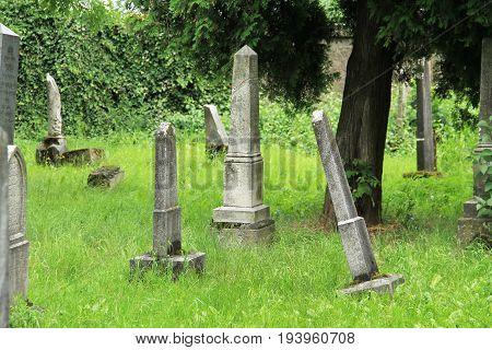 beautiful old tombstones on the jewish cemetery in Frydek-Mistek, Czech Republic, July 2, 2017