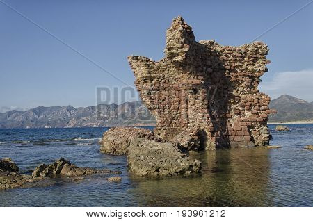 Ancient ruins of a castle emerges from the sea