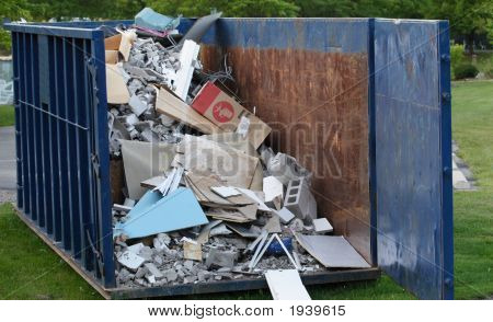 Dumpster With Construction Debris