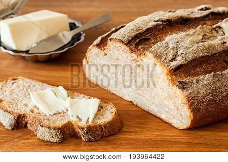 Sliced loaf of wheat bread with bran close-up. Healthy and tasty breakfast
